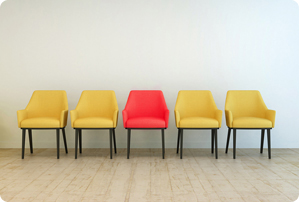 3D Rendering of Row of yellow empty chairs aligned against a gre
